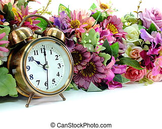 retro alarm clock with flowers on white background