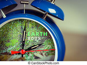 Retro alarm clock with nature background symbolizing Earth hour