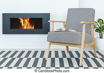 Retro armchair with a book next to a fireplace set on a striped carpet