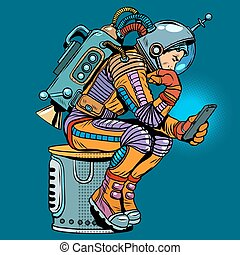 retro astronaut with a smartphone pop art retro style. Thinker. Science fiction. Technologies and gadgets. Mobile phone. Internet and communications