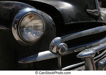 Retro automobile headlight. Close up