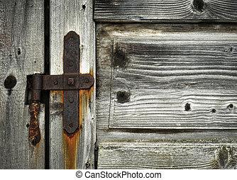 detail of old wooden door hinge