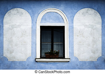 window on the blue old wall