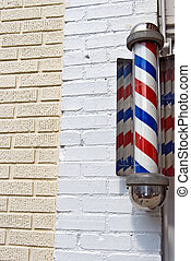 retro barber shop pole - Barber shop pole on brick wall.