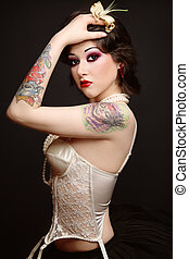 Retro beauty - Beautiful slim young tattooed woman in ballet...