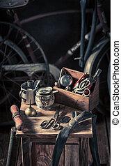Retro bicycle repair workshop with tools, wheels and tube
