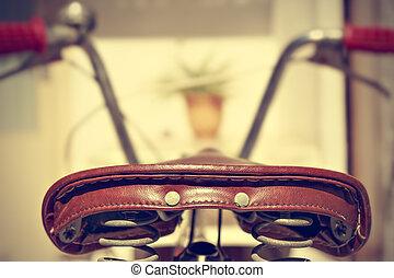 Retro bicycle saddle detail. Vintage style.