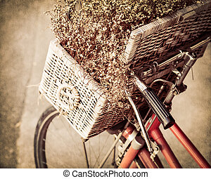 Retro bicycle with flower in a basket
