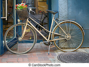 Retro bike with a bouquet of flowers in the basket