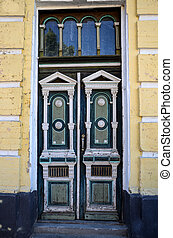 Retro blue doors with interesting finishes and paint that has worn over time