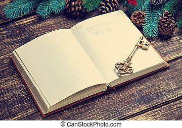 retro, boek, en, klee, dichtbij, dennenboom, takken, op, een, tafel.