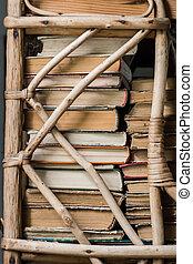 Vintage retro bookshelf with old gorizontal books.