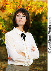 Retro brunette woman in autumn park