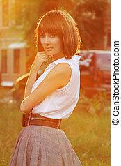 Retro brunette woman in sunset light