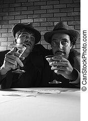 Retro businessmen with martinis. - Two Caucasian prime adult...