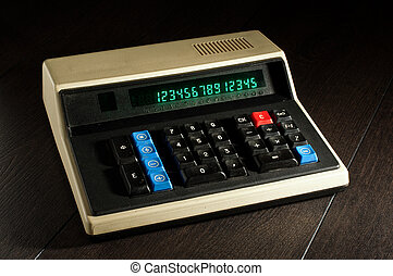 Retro calculator on the wooden table
