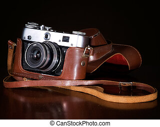 Retro camera - An old photo camera from mid of 20th century.