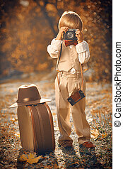 retro camera - Happy little boy stands with his old ...