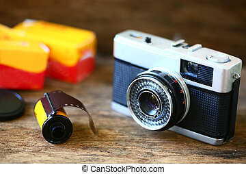 Retro camera with film for photography. Photographer love to...