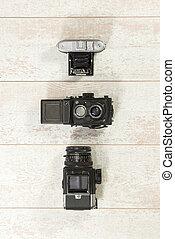 Retro Cameras With Flash On Floorboard