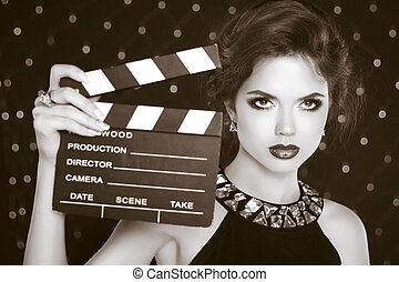 Retro casting tests, woman holding cinema clap. Super star...