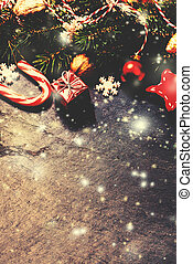 Retro Christmas Card with decorations on dark background in vintage style. Toned filter effect.