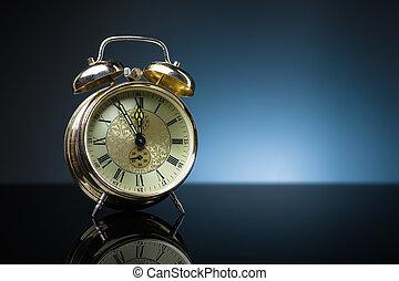 Retro clock, five to twelve, blue background