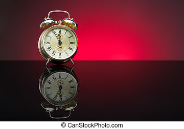 Retro clock, five to twelve, red background
