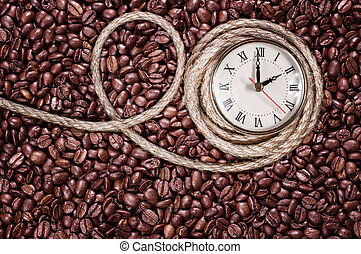 Retro clock on a coffee background