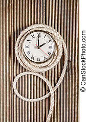 Retro clock on a wooden background