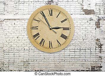 Retro clock on brick wall
