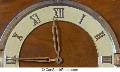 Retro clock with Roman numerals - Close up view of a half...