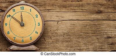 Retro clock with ten minutes to twelve o'clock