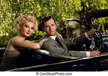 Retro couple in convertible