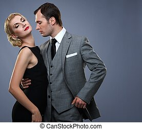 Retro couple isolated on grey background