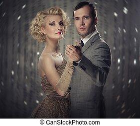 Retro couple over blurred background
