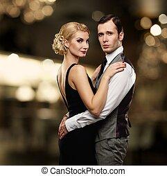 Retro couple over blurred background.