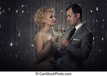 Retro couple with glasses of champagne