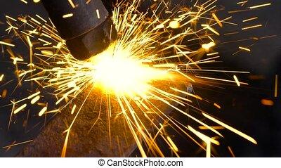 Retro cutter cuts metal parts in a small workshop - Retro...
