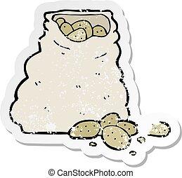 retro distressed sticker of a cartoon sack of potatoes
