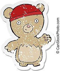 retro distressed sticker of a cartoon teddy bear wearing hat