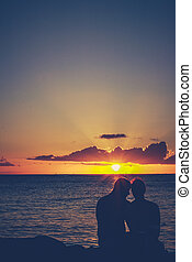 Retro Embracing Sunset Couple - Retro Style Filtered Image ...