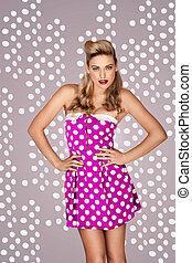 Retro fashion model in polka dot dress