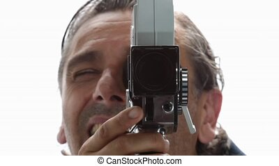 retro filmaker - man with old movie camera over white...