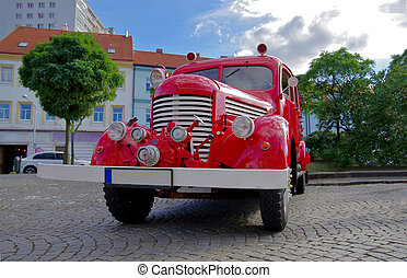 Retro fire truck. Front view of red firetruck.