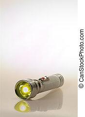 Retro Flashlight - Lit retro flashlight on translucent white...