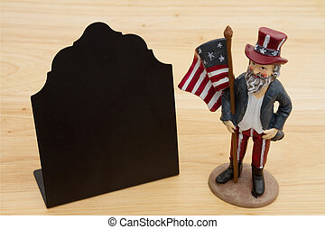 Retro freestanding chalkboard on wood desk with a patriotic man