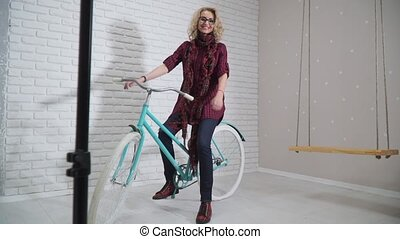 Retro girl on a bicycle in studio