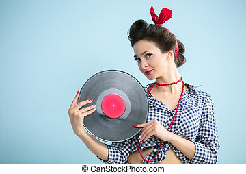 Retro girl with a record.Fifties style woman.