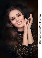Retro glamour woman holding perfume